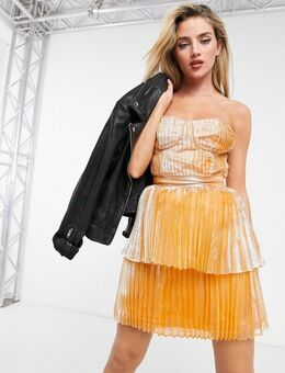Mini-jurk met lagen en korset in goudkleur