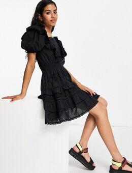 Mini-jurk met ruches en broderie in zwart