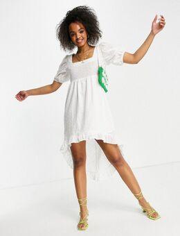 Mini jurk met broderie anglais en lange achterkant in wit