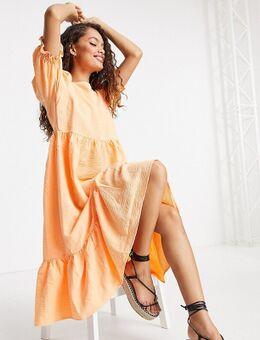 Midi jurk met stroken en textuur in licht koraal-Roze