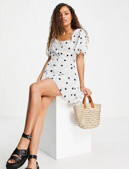 Nette jurk met gemengde stippen in wit