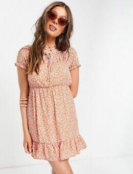 Mini-jurk met pofmouwen in oranje bloemenprint