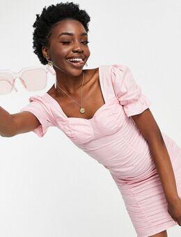 Mini jurk met ruches in roze