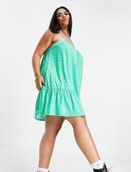 ASOS DESIGN Curve - Mini-jurk met dunne bandjes, aangerimpelde hals en strook langs de zoom in groene bloemenprint