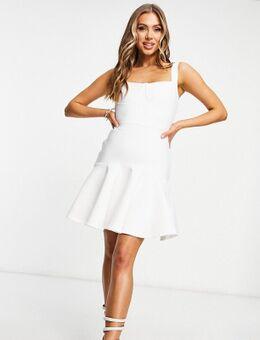 Zwierige mini jurk met bandage-korsetdtail in wit