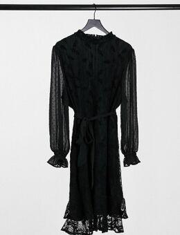 Kanten mini-jurk met hoogsluitende hals en lange mouwen met strikceintuur in zwart