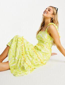 Gelaagde midi jurk met zonneprint en pompons in geel