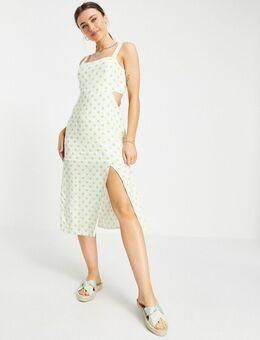 Midi jurk met uitsnijdingen aan de zijkanten in stippenprint-Wit