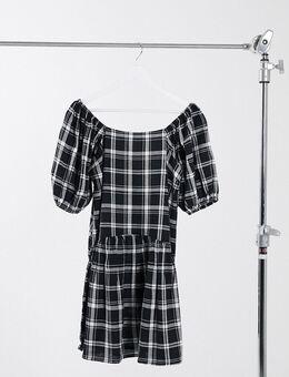 Mini-jurk met pofmouwen en verlaagde taille in zwart-witte ruit