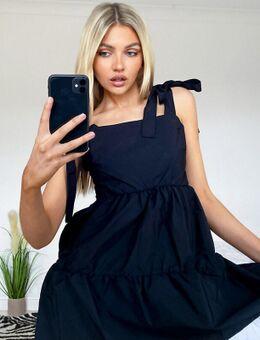 Mini-jurk met strikbandjes in zwart