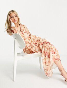 Lange jurk met gestrikte overslag en lange achterkant in beigeroze met bloemen