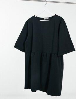 Korte sweaterjurk met lage taille in zwart