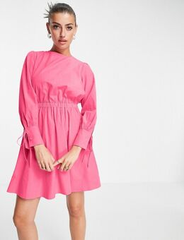 Mini-jurk van biologisch katoen met open, gestrikte achterkant en mouwen met detail in roze
