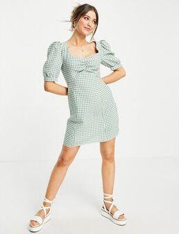 Mini tea dress with puff sleeves in green gingham