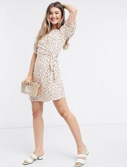 Wrap mini dress in white ditsy floral