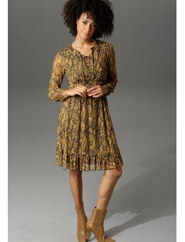 NU 20% KORTING: party-jurk in slangen-look of grafische print all-over